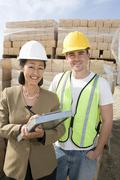 Female Architect And Worker At Site - stock photo