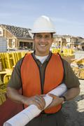 Happy Architect With Blueprint At Site Stock Photos