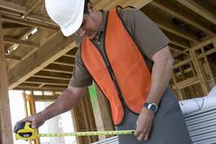 Architect Working At Construction Site - stock photo