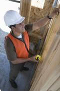 Architect Measuring Wooden Beam Stock Photos