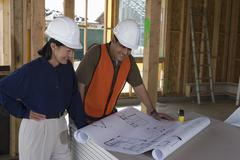 Engineer And Co-Worker Working Over Blueprint Stock Photos