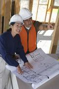 Co-Worker Discussing With Female Engineer Stock Photos