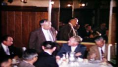 569 - salesmen speak at the company business lunch - vintage film home movie Stock Footage