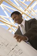 Architect Holding Blueprint Stock Photos