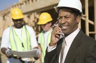Stock Photo of An Architect On Call With Workers In Discussion