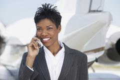 Business Woman On Call At Airport Stock Photos