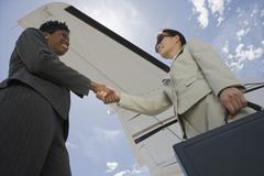 Successful Businesswomen Shaking Hands - stock photo