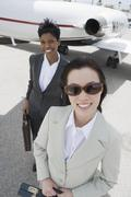 Two Business Women At Airfield - stock photo