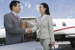 Business Handshake At Airfield Stock Photos