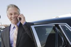Businessman Using Cellphone Standing By Car Stock Photos