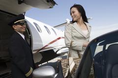 Businesswoman Looking At Airplane Pilot Stock Photos