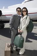 Business Couple Standing Together At Airfield Stock Photos