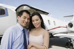 Stock Photo of Business Couple Smiling Together At Airfield