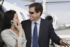 Business Couple Looking Each Other At Airfield Stock Photos