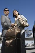 Business Couple Standing At Airfield Stock Photos