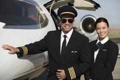 Cabin Crew Members By An Aircraft - stock photo