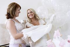 Stock Photo of Bride Showing Off Dress At Bridal Shower
