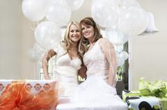 Stock Photo of Bride And Friend Standing Together At Bridal Shower