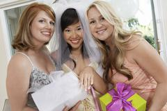 Bride Showing Her Engagement Ring With Friends Holding Gifts - stock photo