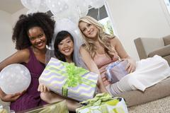Bride And Friends Holding Gifts At Hen Party - stock photo