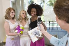 Bridge's Mother Photographing Bride And Her Friends - stock photo