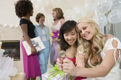 Bridge And Friend Looking At Engagement Ring At Hen Party - stock photo