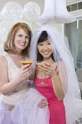 Bride And Her Friend Holding Juice Glasses Stock Photos