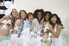 Group Holding Wedding Bells At Hen Party Stock Photos