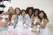 Stock Photo of Group Holding Wedding Bells At Hen Party