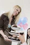 Friends Having Cupcake At A Baby Shower Stock Photos
