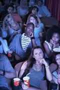 Stock Photo of People Watching A Boring Movie