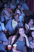 Ihmisiä katsomassa Boring Movie Kuvituskuvat