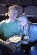 Couple Watching Movie Together In Theatre Stock Photos