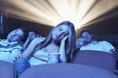 People Sleeping In The Movie Theatre - stock photo