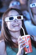 Young Woman Watching A 3D Movie In Theatre Stock Photos