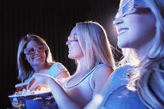 Young Women Wearing 3D Glasses In Theatre - stock photo
