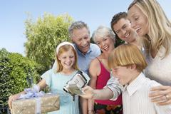 Family Watching Video Together - stock photo