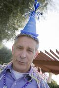 Senior Man With Birthday Cap Stock Photos