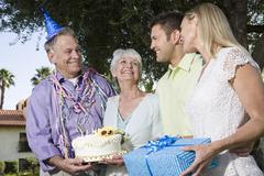 Two Couples During A Birthday Party In Garden - stock photo