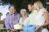 Stock Photo of Two Couples During A Birthday Party In Garden