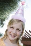 Stock Photo of Teenage Girl Wearing Birthday Cap