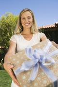 Mature Woman Giving Gift - stock photo