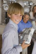 Teenage Boy Holding Gift - stock photo