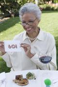 Happy Senior Woman Sitting - stock photo