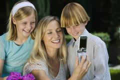 Mother Clicking Self Photo With Kids Stock Photos