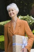 Senior Woman With Gift Box Stock Photos