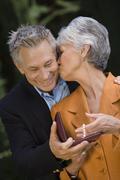 Stock Photo of Wife Kissing Husband On Cheek