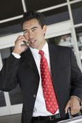 Businessman Using Cellphone Outside Office Stock Photos