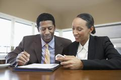 Business Colleagues Reading Document Stock Photos