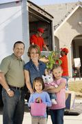 Family In Front Of Delivery Van And House - stock photo